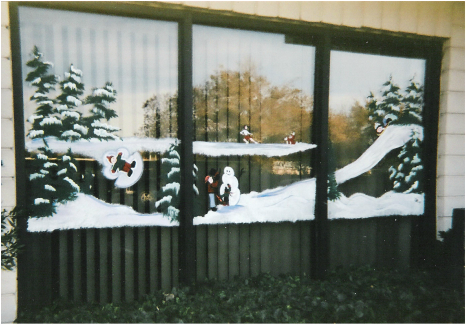 snow scene window painting with different scenes of snow play: skating, sledding, snowman building, making a snow angel. Image: M Burgess - window painter