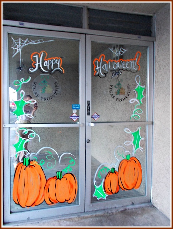 Halloween window painting, pumpkins, spiders, web, orange, green, leaves