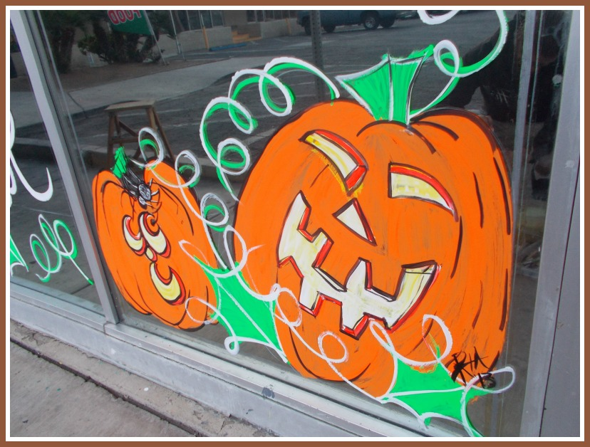 Painted Jack O' Lanterns dress up an office window